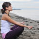 woman yoga beach deep breathing exercises