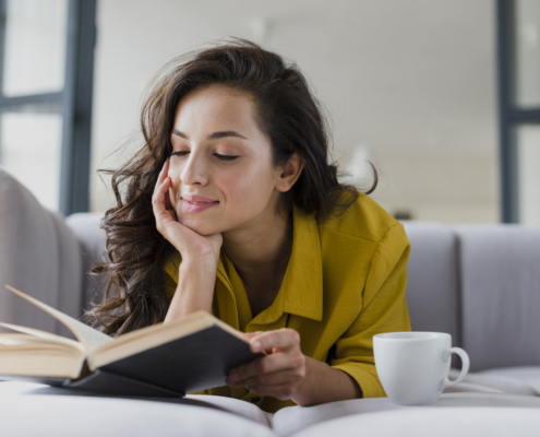 woman happily reading alone